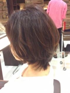 グラマラスなカットのヘアスタイル1
